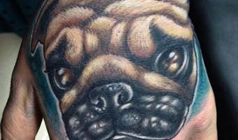 hand-pug-tattoo-by-oash-rodriguez-of-la-costa-nstra-tattoo-madrid-spain