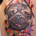 Arm pug tattoo on Kara Clark by Andy Joss