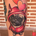 Leg pug tattoo by Debora Cherrys of La Mujer Barbuda, Spain