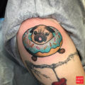 Donut Pug Tattoo by Christina Hock of the Dolorosa tattoo company