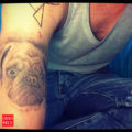 Arm pug tattoo on Yerko Lopez