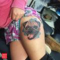 Leg pug tattoo by Eduardo Crow