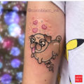 Arm pug tattoo by Coco Blacc Tattoo